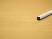 Cigarette. On wooden background and copy space Royalty Free Stock Photo