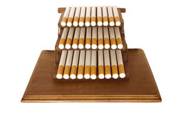 Cigarettes. It is a lot of cigarettes on a support on a white background stock photography