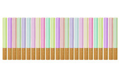 Cigarettes. Multi-coloured cigarettes on a white background royalty free stock photo