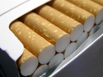 Cigarettes. Detail close-up of cigarette filters in blank pack Royalty Free Stock Image