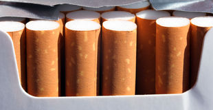 Cigarettes. Close up of an opened cigarettes box Stock Photos