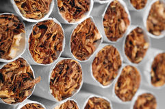 Cigarettes. Stacked sigarettes photographed on an angle with shallow DOF Royalty Free Stock Photography