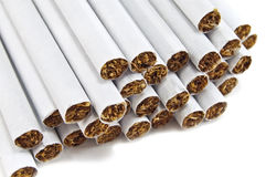 Cigarettes. Heap of cigarettes on white Stock Images