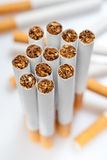 Cigarettes. Disposed disorderly over white background Royalty Free Stock Photos