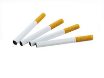 Cigarettes. Four cigarettes isolated over white background Royalty Free Stock Photo