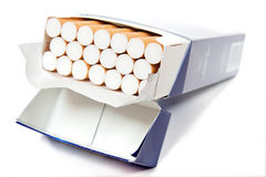 Cigarettes. Blue pack of cigarettes on white background stock images