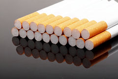 Cigarettes. Some cigarettes on dark background Royalty Free Stock Photography