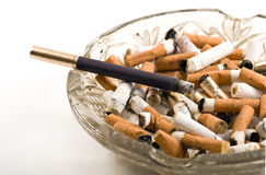 Cigarettes and ash tray Stock Images
