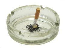 Cigarettes in ash-tray Stock Photography