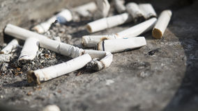 Cigarettes in an ashtray. Details of cigarettes and ash in an ashtray Stock Photography