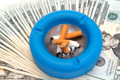 Cigarettes Ashtray And Money Stock Photos