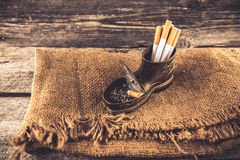 Cigarettes and ashtray Stock Images