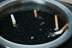 Cigarettes in Ashtray Stock Image