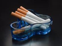Cigarettes and ashtrays. Stock Photography