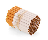 Cigarettes associated with rope isolated on white. Royalty Free Stock Photography