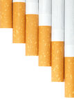 Cigarettes avec un filtre brun image libre de droits