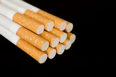 Cigarettes on a black background Stock Photo