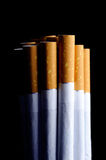 Cigarettes on Black Background Stock Photography