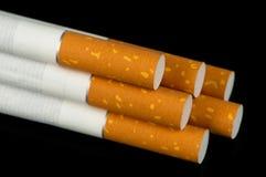 Cigarettes on Black Background Stock Photography