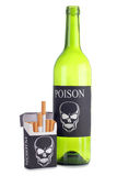 Cigarettes and bottle Stock Image