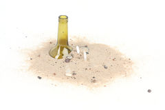 Cigarettes and bottle in beach sand isolated on white background Stock Photography