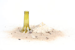 Cigarettes and bottle in beach sands on white background Stock Photo