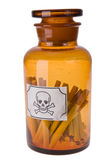 Cigarettes in bottle of poison Royalty Free Stock Images
