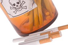 Cigarettes in bottle of poison. On white background Royalty Free Stock Photography
