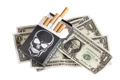 Cigarettes box and money Stock Photo