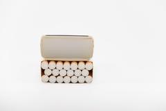 Cigarettes in box. Box of twenty cigarettes on white Stock Image
