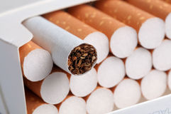 Cigarettes with brown filter in the box Royalty Free Stock Photo