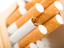 Cigarettes with a brown filter. Tobacco in cigarettes with a brown filter close up Royalty Free Stock Photo