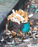 Cigarettes butt in can ashtray. Stock Photography