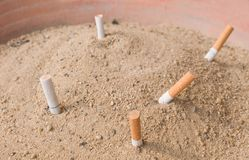 Cigarettes Butts in An Ashtray Big Bin Stock Photos