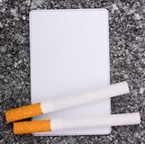 Cigarettes and card Royalty Free Stock Images