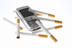 Cigarettes and cell phone. A bunch of cigarettes and a cell phone Royalty Free Stock Images