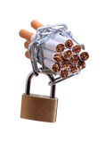 Cigarettes with chain and padlock Stock Image