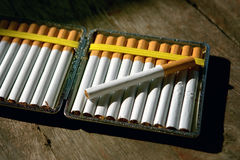 Cigarettes in cigarette case Stock Images