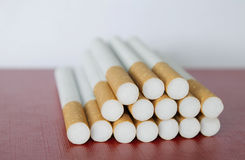 Cigarettes. Close up of cigarettes on board with white background Stock Photos