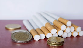 Cigarettes. Close up of cigarettes on board with white background Stock Image