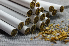Cigarettes close-up on a gray background Royalty Free Stock Photography