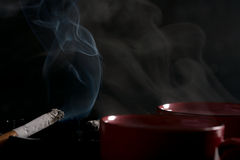 Cigarettes and coffee. Royalty Free Stock Image