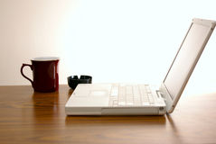 Cigarettes coffee and laptop Royalty Free Stock Photography