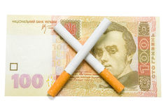 Cigarettes crossed over one hundred hrivna Stock Photography