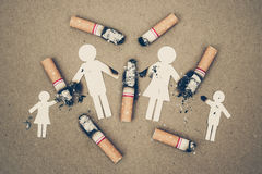 Cigarettes destroying family. Paper cut of family members destroyed by cigarettes / drugs destroying family concept / world no tobacco day royalty free stock photography
