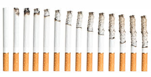 Cigarettes During Different Stages of Burn. Royalty Free Stock Photo