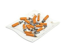 Cigarettes on a dish Stock Photography