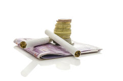 Cigarettes with Euro money. Two cigarettes with stack of Euro coins and banknotes. Isolated over white background. Concept of expensive smoking habit Royalty Free Stock Photos