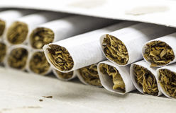 Cigarettes without filter. The open pack of cigarettes without filter closeup Stock Photography