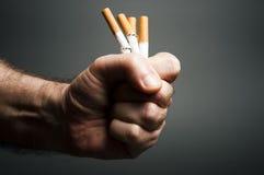 Cigarettes in fist Stock Image